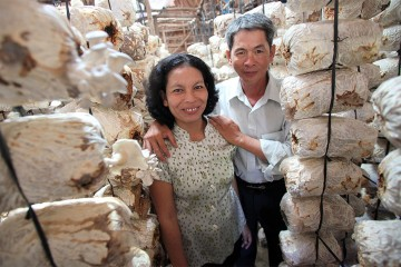 Cec Thach Cue and her husband Sung Nguyen's lives were changed when a CARE micro-finance project provided them with loans, training and support to start their mushroom-growing business. ©Josh Estey/CARE