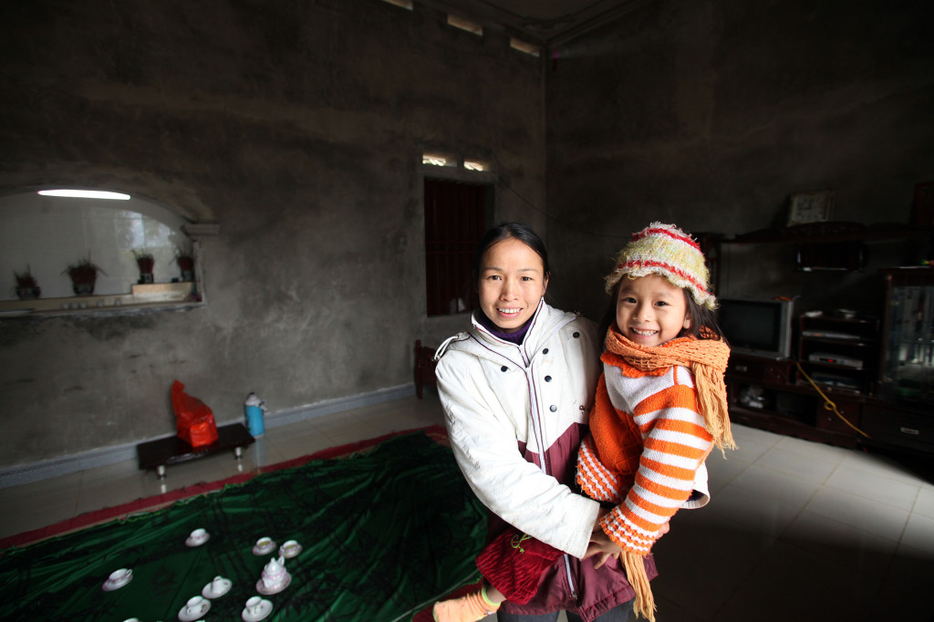 Ma Thi Huong is 35 and a local farmer trainer on pig and sow raising. Through her involvement in the project she participated in training activities and provided with her new techniques which have seen her piglets gain weight faster, contract few diseases and therefore increase her income. With the extra income she has been able to build a new home for her family. Image: Josh Estey/CARE