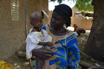Adama and her daughter in August 2012, when Eduwa* was suffering from malnutrition. ©CARE
