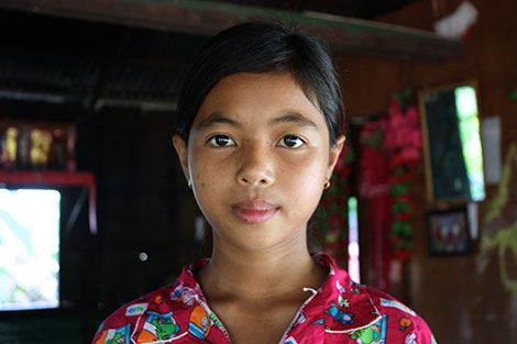 Bopha misses school because she is burdened by collecting water and helping run her household.