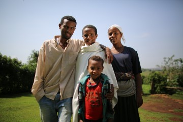 Asmarech's family were often sick due to drinking dirty water. Thanks to a CARE project in her village in Ethiopia, access to safe, clean drinking water has transformed them from unhealthy to healthy. ©Josh Estey/CARE