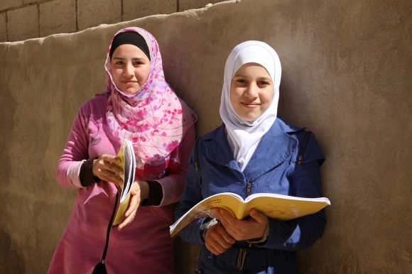 "Rosa* and Njood*, 14, Syrian refugee girls living close to Amman: ""I have seen so many people suffer. I want to come up with solutions; I want to help. I don't want to feel powerless. I want to invent medication that helps against sadness."""
