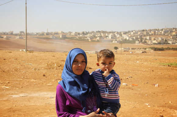 "Sahab, 24, Syrian refugee mother in a tented settlement close to Amman: ""I wish my children could grow up safe, sound and healthy. I am pregnant, but I wish I did not have to give birth to my child as a refugee. I wish I was able to raise my children in a place that I call home."""