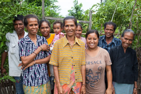 Benvinda (centre) is the leader of a farmer's group CARE is supporting in Timor-Leste. The farmers work together and with the training, improved seed varieties, tools and materials provided by CARE they are able to increase crop yield, earn an income and build their resilience to cope during times of food shortage. Image: Tom Greenwood/CARE.