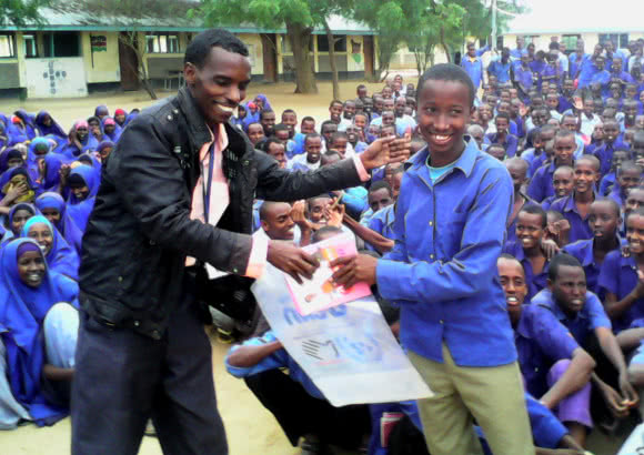 Hassan with students at a CARE ran school in the Dadaab refugee camp, Kenya