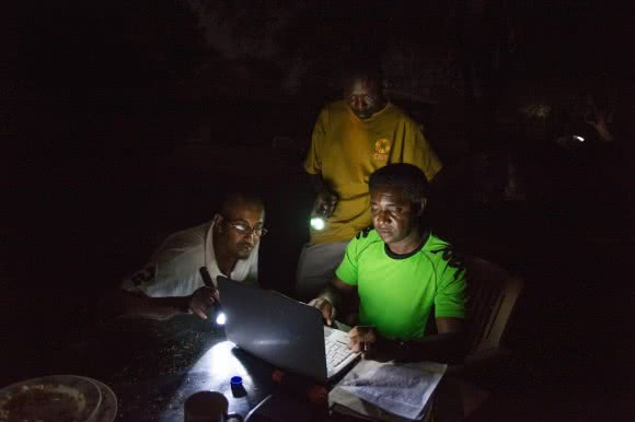 WFP and CARE staff work into the night to record the days activities during a rapid response mission to Pagak in South Sudan's Upper Nile State.By Dan Alder