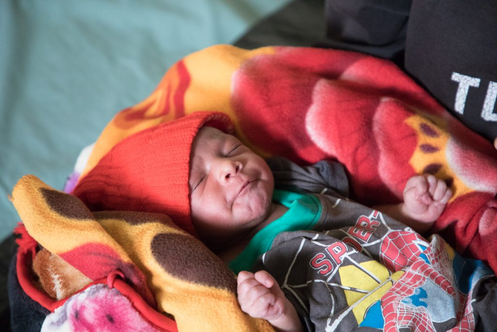Anita's daughter is one day old and able to receive a polio vaccination thanks to CARE