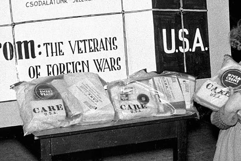 A girl receives CARE packages on courtesy of the Veterans of Foreign Wars.