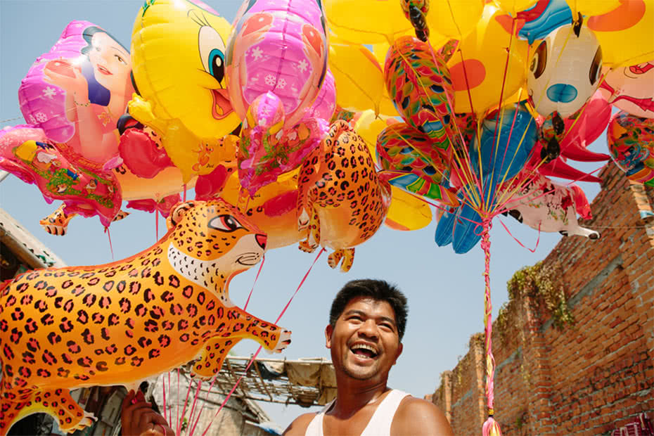 Aung Myit's partner is living with HIV and they received a small business grant from CARE to help increase the family's income. They used it to start a business selling balloons in Mandalay. ©Tom Greenwood/CARE