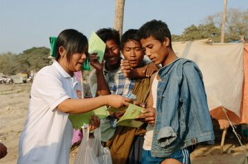 Condom distribution to dock workers in Mandalay, facilitated by CARE. ©Tom Greenwood/CARE.