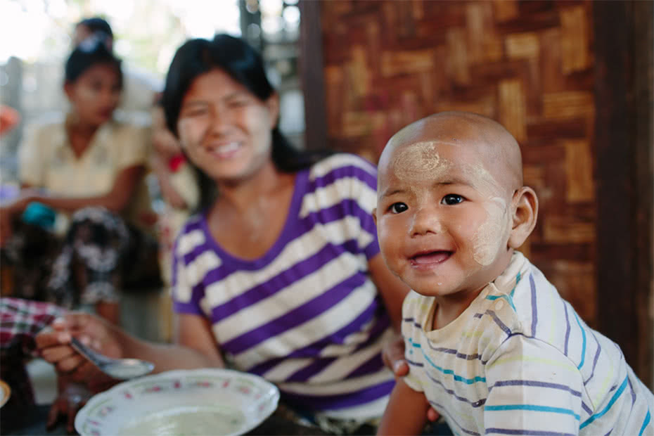 Members of a self-help group for people living with HIV organised a celebration for Myanmar Child Day, cooking rice soup for local children. ©Tom Greenwood/CARE.
