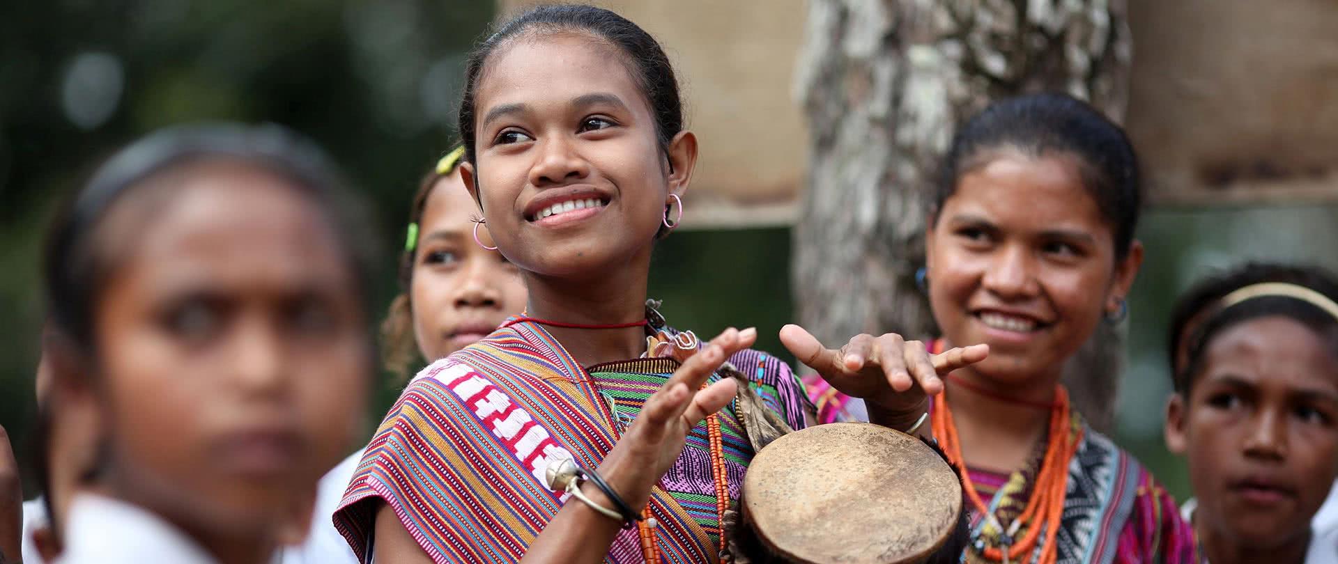 homepage-slide-1920-josh-estey-girl-drum-timor-leste
