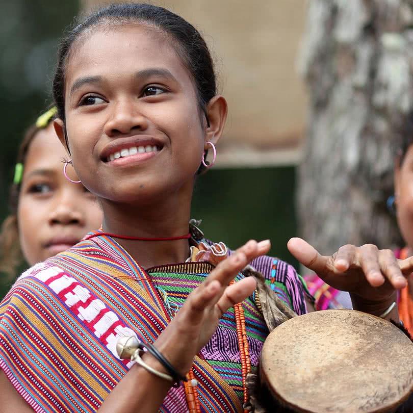 homepage-slide-mobile-1920-josh-estey-girl-drum-timor-leste