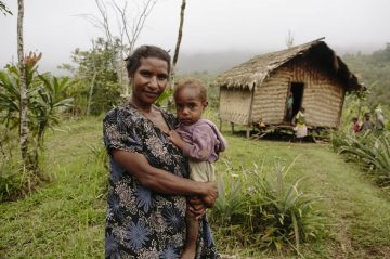Dorina in remote Papua New Guinea, with her first child. ©CARE