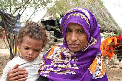 Yemen_Country_Page_930_Karina_Coates_Woman_Child
