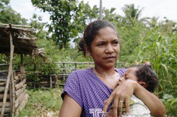 Amelia Saramento, 32, and baby Antonio. Aldeia Kota-Foun, Suco Lalawa, Suai, Timor Leste.