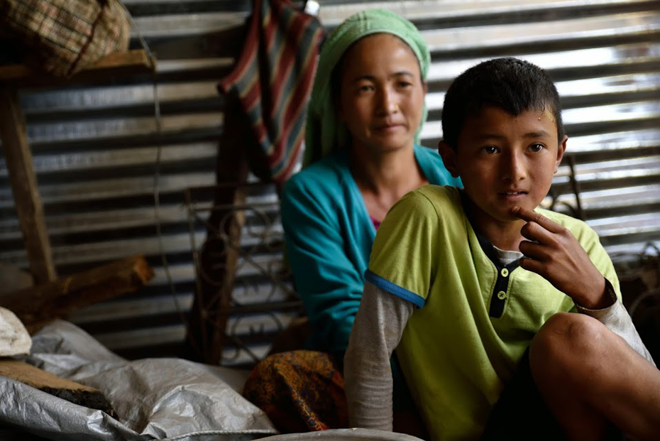 Ittha Kumari sits with her son who is about to start back at school. Photo: © Lucy Beck/CARE