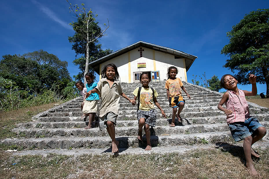 Girls running and playing in Timor Leste
