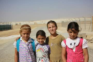 Syrian girls outside of a refugee camp.