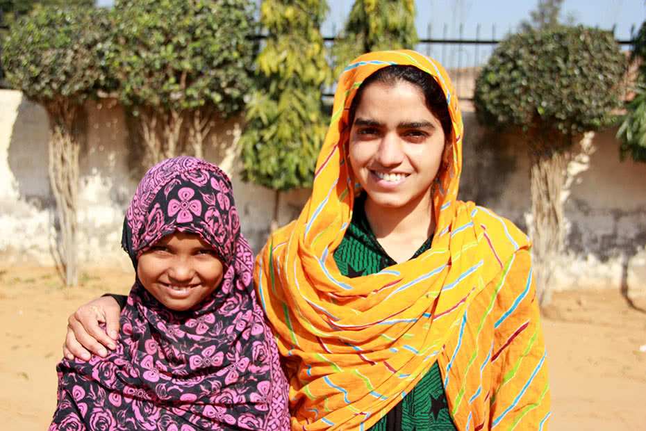 Indian schoolgirl Anusha with her teacher Saina.