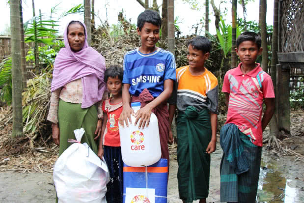 Widower and Myanmar floods survivor Kaw Tiza with her family.