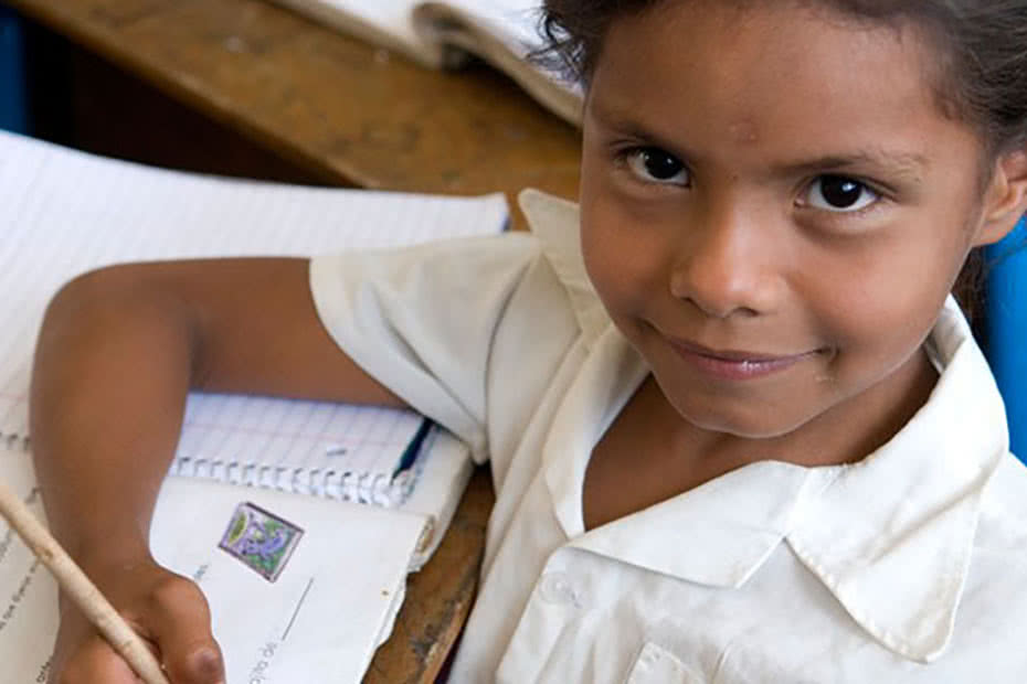 Seven-year-old Anna Maria from Nicaragua in her school classroom.