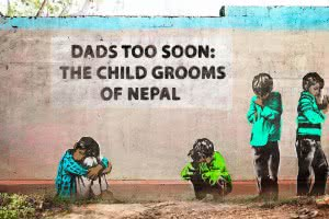 "Artwork on wall picturing boys with text ""Dads too soon: The child grooms of Nepal"""