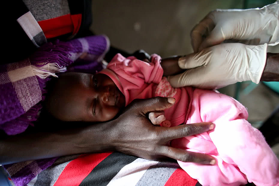 A baby swaddled in cloth in South Sudan