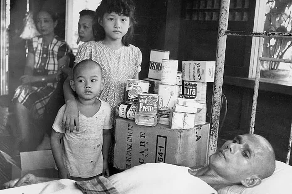 Historical photo of a Philippines family receiving CARE packages.