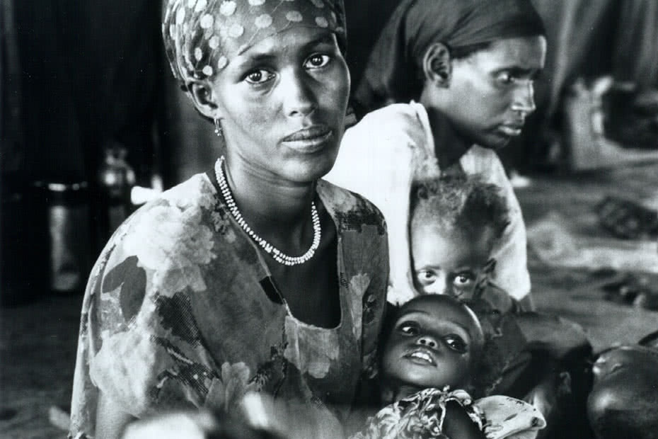 Historical image of Ethiopian mother and child assisted by CARE.