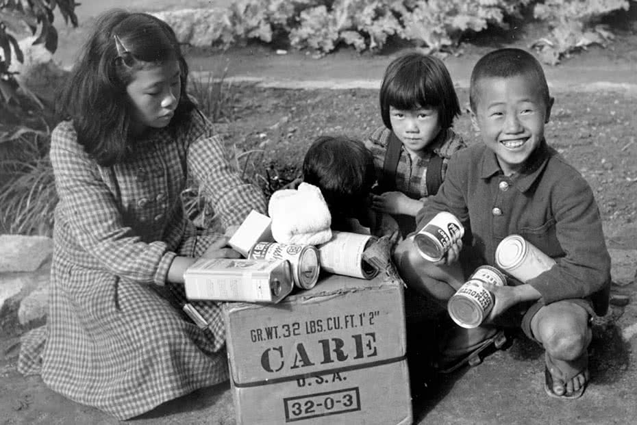 Historical photo of a Japanese family receiving CARE packages.