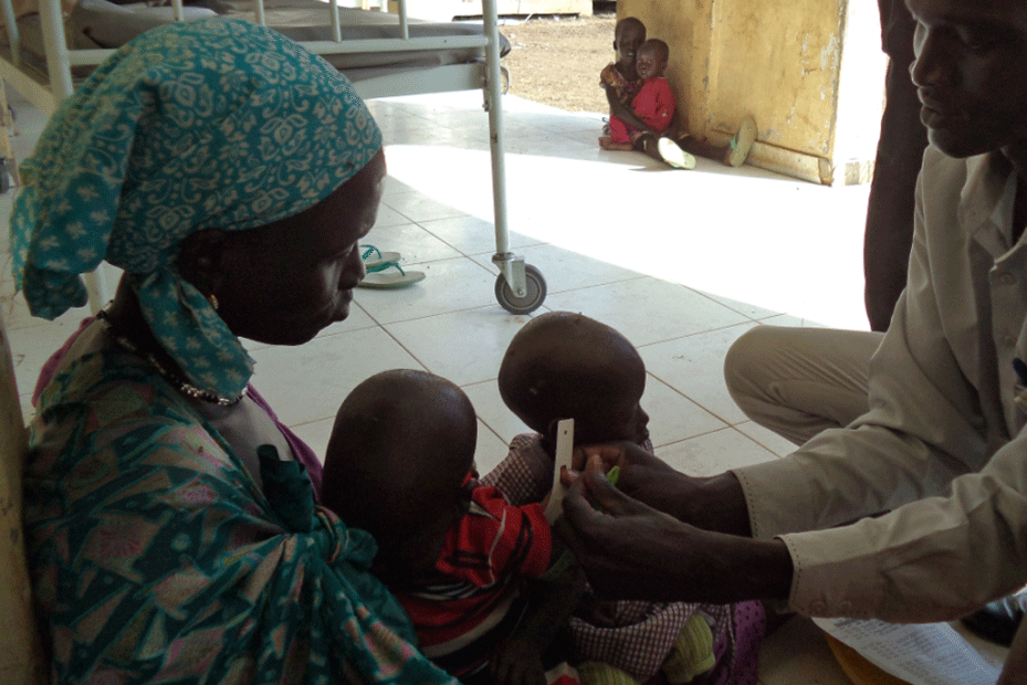 A mother and her child receive medical attention at a health clinic in South Sudan.