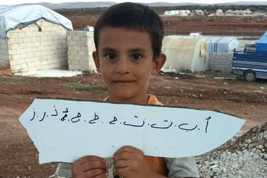 blog-what-we-left-behind-930-boy-arabic-sign-2-syria