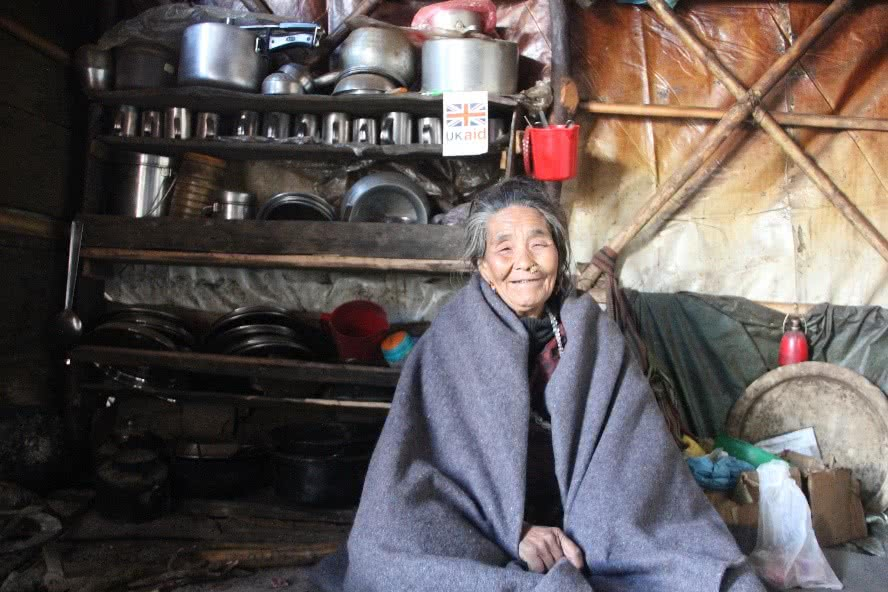 preparing-for-harsh-winter-in-nepal-woman-sitting-in-tent