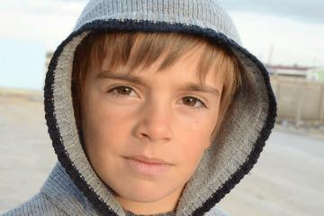 A Syrian refugee boy.