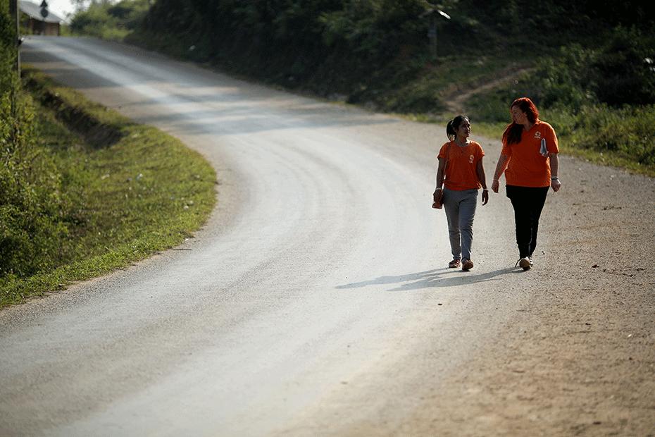 Meagan (pictured right) speaks with local CARE Laos staff. © Josh Estey/Laos
