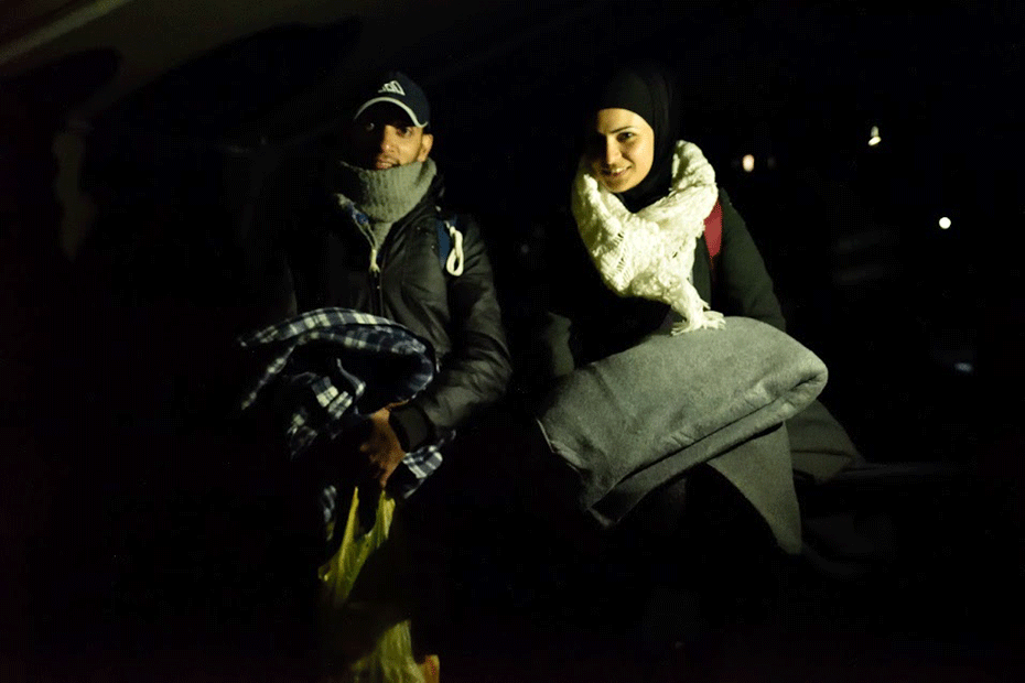Syrian refugees and newlyweds Noor and Amfiraz with emergency supplies provided by CARE.