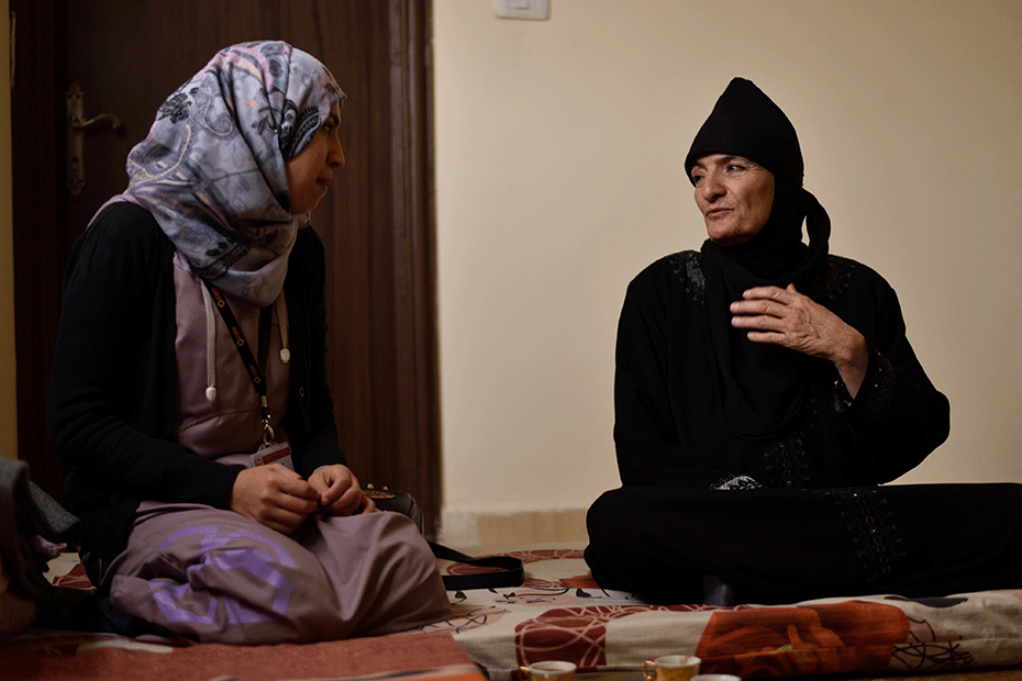 Syrian refugee Amira* (pictured right) speaks to local CARE staff.