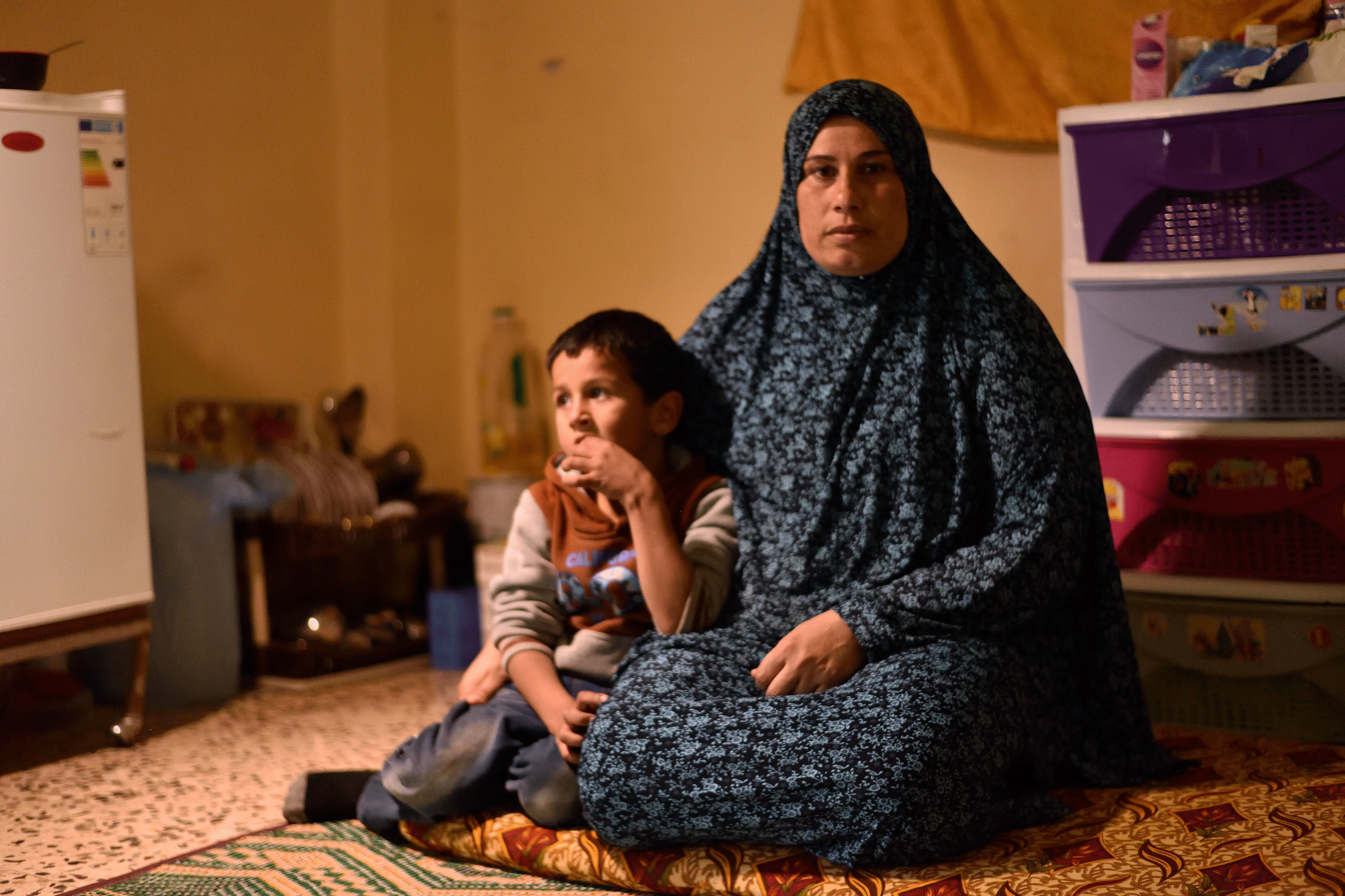 Single mother Sanaa lives in the one room with her eight children. They are refugees from Syria.