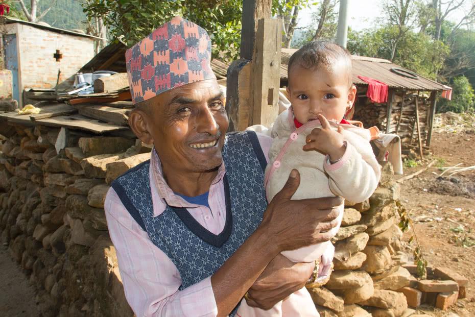 Narayan Shrestha with his granddaughter