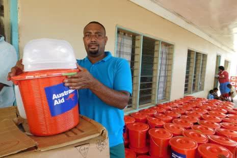Volunteer Sepesa prepares the Hygiene Kits for distribution