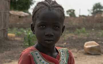 Nyaching spends much of her time caring for her younger brother in South Sudan.