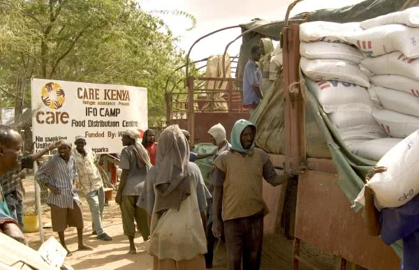 Workers preparing to unload bags of food at the Dadaab refugee camp in Kenya. Over 1,500 Somali refugees were arriving daily as a result of the ongoing drought. CARE distributed emergency food rations, blankets, water containers, sleeping mats and plastic sheets.