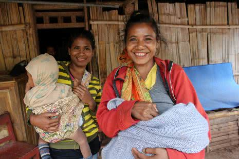 Claudina Gomes, 30, just had her 3rd child and is part of the SMP group for one year. She joined because she was intererested in the vegitible garden and wanted to eat better. She works within the community garden because where she lives she has difficulty accessing water.  She lives in the Village of Suco Leimea Leten, in the District of Atsabe in Central Timor on the 3 of March 2015. The Safe Motherhood Project (SMP) has been running one-year and brings training and education in nutrition and maternal health including kitchen gardens and mothers groups to communities in Timor Leste. Photo by Josh Estey/CARE