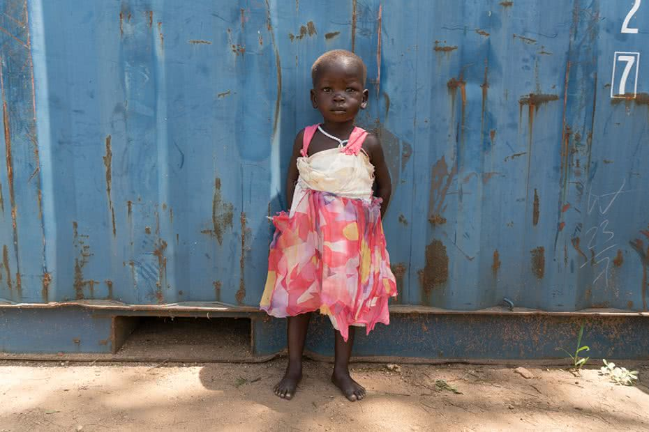 Two-year-old Paska in South Sudan. Her family's home was burnt to the ground in July. Image: Lucy Beck/CARE