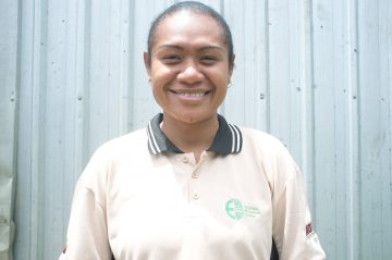 Alma is the first female coffee graduate placed with SMS-PNG. Image: Patrick McCloskey/CARE.