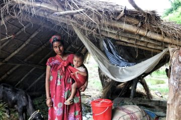 Ishwori in the temporary shelter where she is currently living with her family.