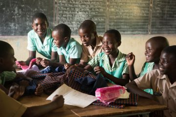 Classroom shots are of students learning how to sew reusable sanitary pads. Boys and girls learn about girls' periods to reduce stigma and work together to help girls keep coming to school, even when menstruating.