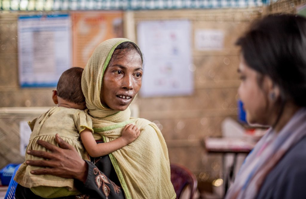 Woman with baby visiting health centre in Bangladesh
