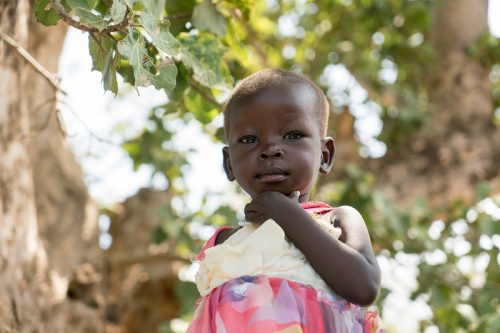 Two-year-old Paska in Torit, Eastern Equatoria, South Sudan. Her family received relief items from CARE including soap, tarpaulins, blankets, jerry cans, mats, and cloth. Their home was burnt to the ground by armed men who came to the town on 11 July 2016 and Paska lost three of her siblings who drowned trying to cross a nearby river. Their bodies washed up down river three days later.  Background: CARE has been operating in Southern Sudan since 1993, providing humanitarian relief to internally displaced people in Western Equatoria, Jonglei State and Upper Nile. South Sudan has the highest inflation rate in the world, at over 700%. The ongoing civil war has led to wide spread insecurity, hunger, and exploitation of women and girls. 1.6 million people are currently displaced and 5.1 million people are in need of aid. CARE is working in Health, Nutrition, Food and Security, Livelihoods, Peace Building and Gender.  The images were taken in and around Mankien, Unity State, South Sudan during November 2016.